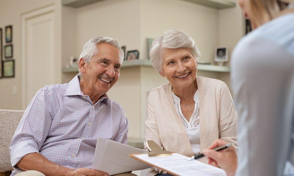 senior couple meeting financial advisor min
